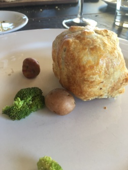 Filet Mignon wrapped in puff pastry, mushroom duxelle and, cured ham.