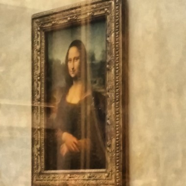 Mona Lisa displayed at the Louvre.